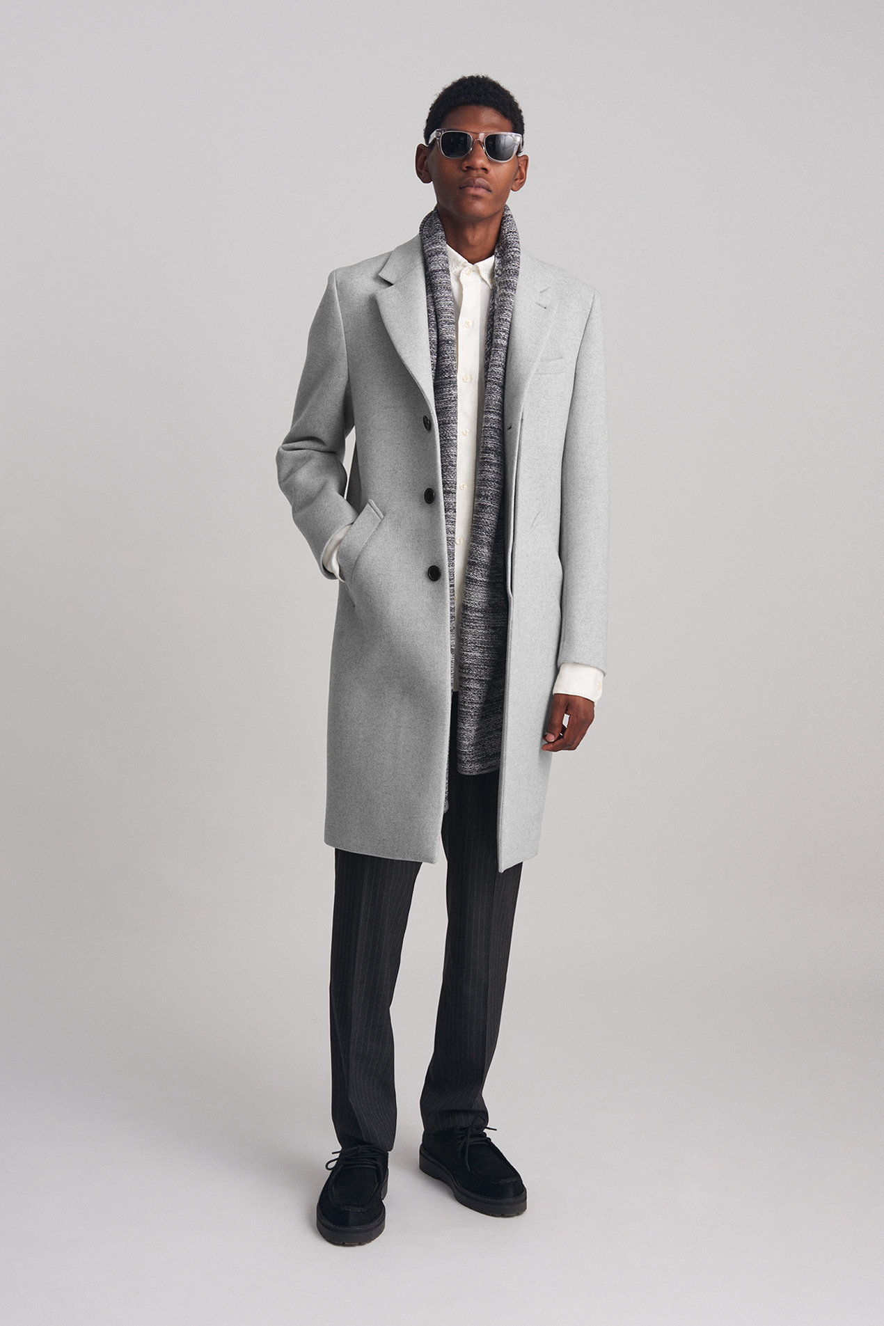 The Morgan Wool Coat in Ash Heather paired with the Panos Trousers, Laszlo Trousers and a Scarf