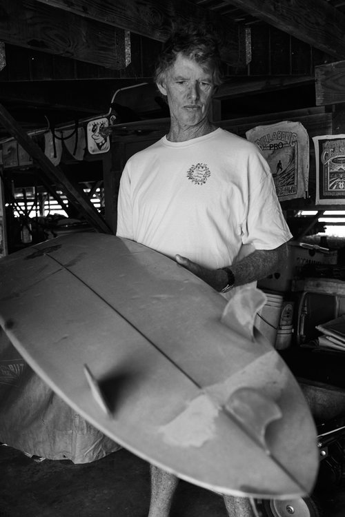 Rick Williams examining the undersideof a repaired owl board