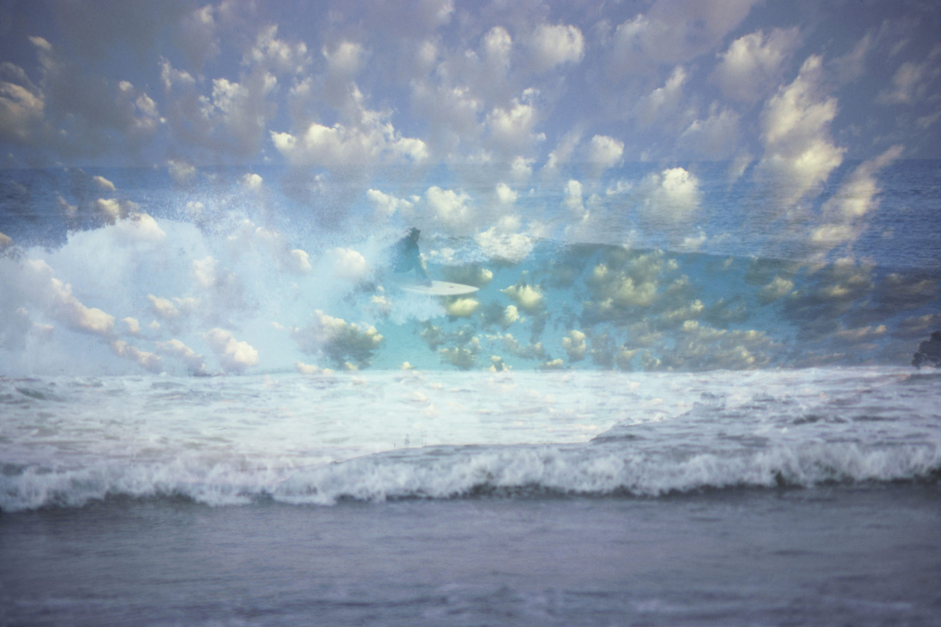 Surfer in clouds, Ronnie Jay